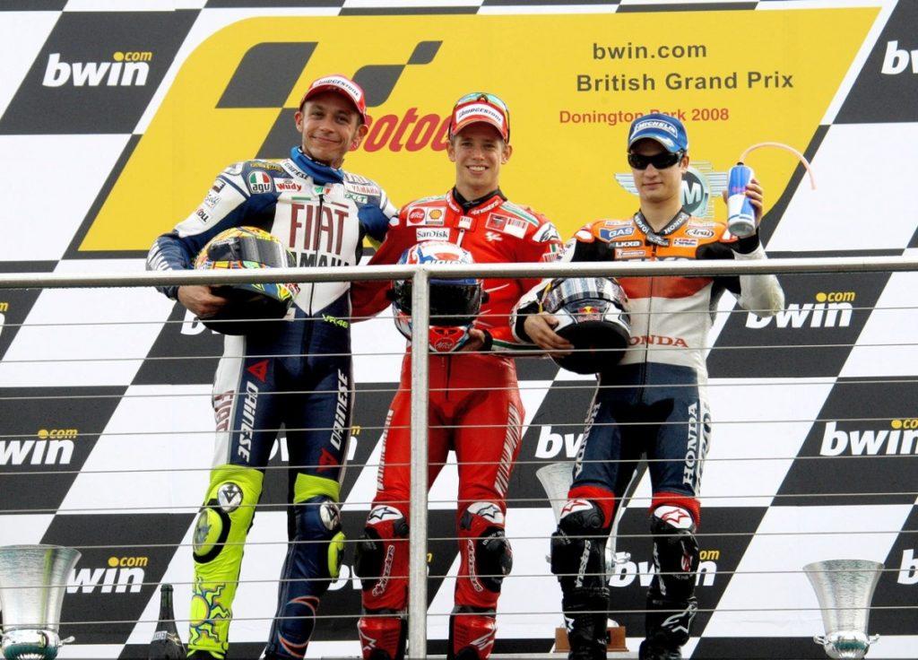225825_stoner-rossi-and-pedrosa-on-the-podium-at-donington-motogp-1280x960-jun22-jpg