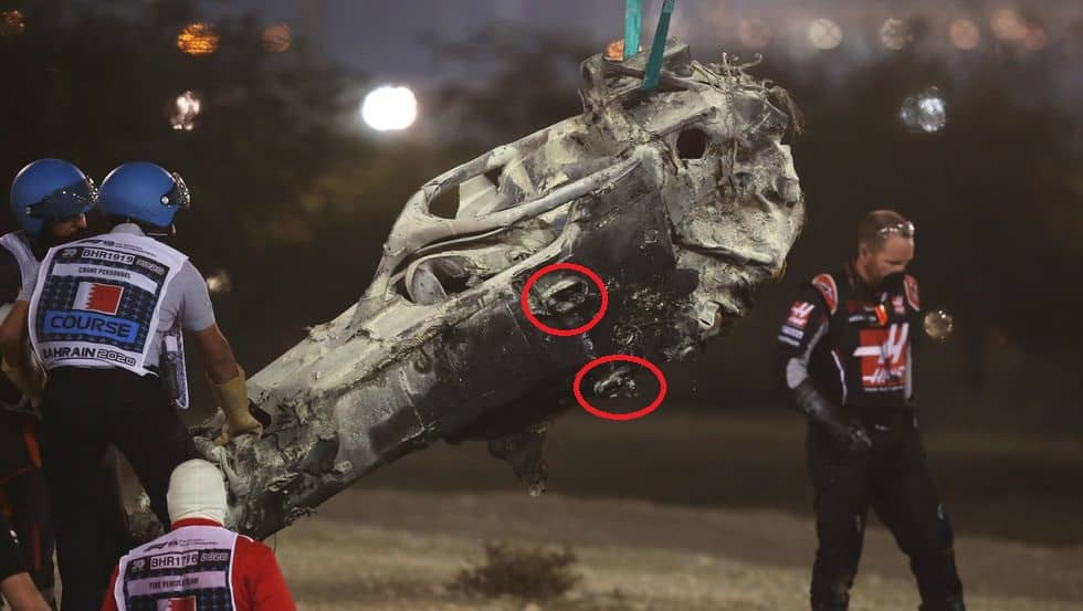 track-marshals-clear-the-debris-following-the-crash-of-news-photo-1606750886